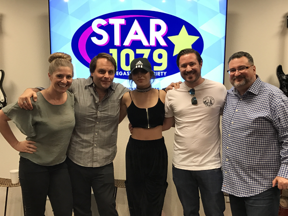 0e6108e7ea231 Charlie XCX Visits Beasley Las Vegas. Pop star and Road Runner Atlantic  Records recording artist Charlie XCX poses for a photo backstage with some  of the ...