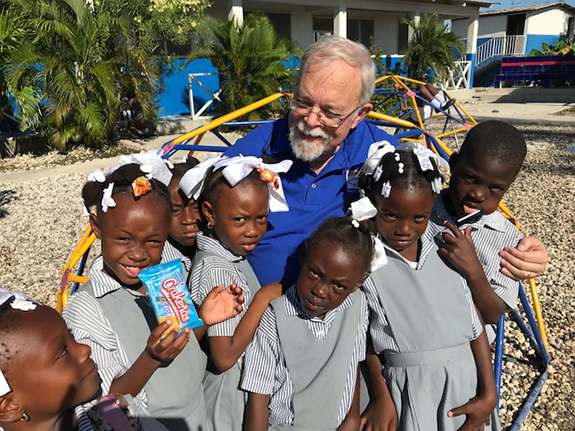 Doing Relief Aid in Haiti. Pictured above is Salem Radio Network vice  president news & talk programming Tom Tradup with a group of children in  Citi de ...